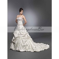 Ball gown floor-length satin bridal gown with ruffle embellishment