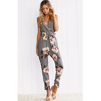 FLORAL CROSSOVER JUMPSUIT