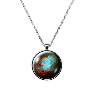 Orion Nebula - Necklace Jewelry stainless steel casing crystal glass pendant hosting the Orion Nebula .