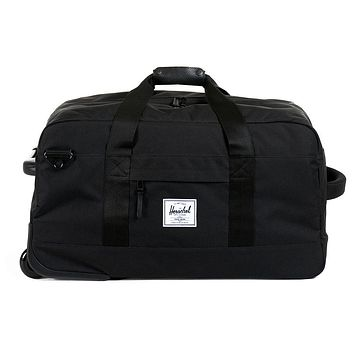Wheelie Outfitter Travel Duffle in Black by Herschel Supply Co.