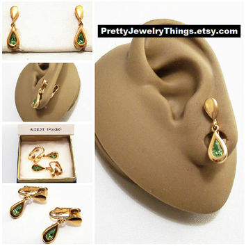 Avon Green Peridot Crystal Teardrop Clip On Earrings Gold Tone Vintage 1977 Austrian August Birthstone Glass Stone Bezel Set Wide Band Edge