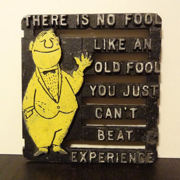 """Vintage Cast Iron Funny Footed Trivet """"There Is No Fool Like An Old Fool You Just Can't Beat Experience"""""""