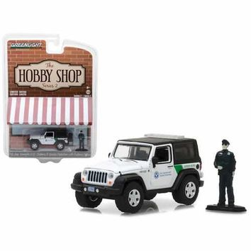 """2016 Jeep Wrangler US Customs and Border Protection with Officer Figure """"The Hobby Shop"""" Series 2 1/64 Diecast Model Car by Greenlight"""
