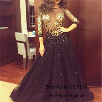 Sexy See Through Deep V-neck Gold And Black Beading Prom Dresses Long Sleeves Open Keyhole Back Evening Party Dresses