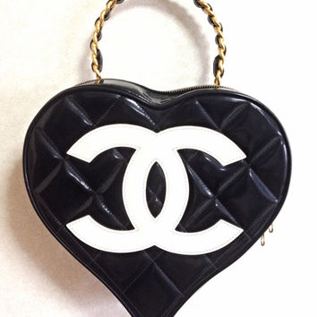 Vintage CHANEL black patent enamel quilted leather large heart shape vanity handbag with white cc mark and golden chain handle. Rare purse.
