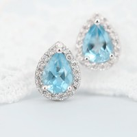 Magic Pieces Sterling Silver Earrings with Faceted Pear Shape Blue Topaz and CZ