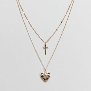 ASOS DESIGN Vintage Style Dagger And Heart Locket Pendant Multirow Necklace at asos.com