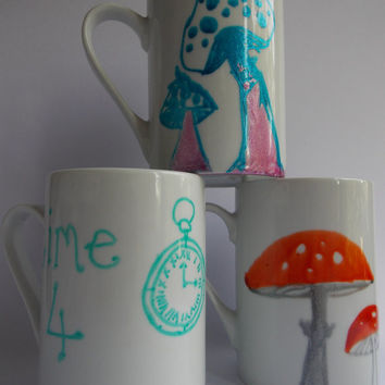 Hand painted mugs. Fly Agaric mushrooms, blue and cerise mushrooms, Alice in wonderland inspired tea mug. Pocket watch time 4 tea fairies