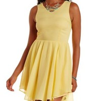 Pale Yellow Pleated Chiffon Skater Dress by Charlotte Russe