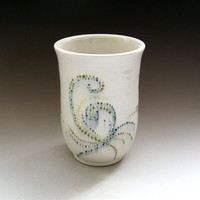 Whimsical hand-painted porcelain tumbler with slip design