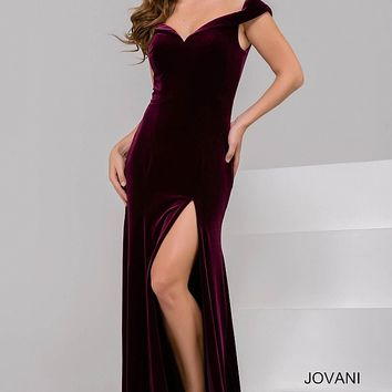 Burgundy long fitted off the shoulder high slit velvet dress.