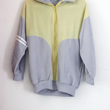 Vintage sports jacket, very soft ( flannel material - suede) zip, two-tone pastel yellow and light gray. 80s