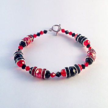Harley Quinn bracelet .. Black and red glass beads, rhinestone spacers with a silver plated toggle clasp.