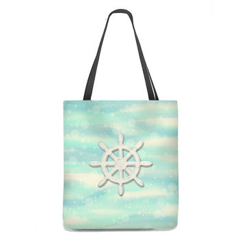 Ship's Wheel Tote Bag on sea and sand with bubbles