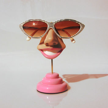 Smiling eyeglass holder, nose sunglasses display, too happy glasses stand