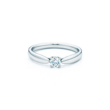 Tiffany & Co. - Tiffany Harmony™ ring in platinum with a round brilliant diamond.