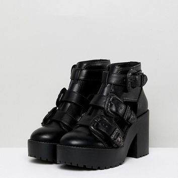 ASOS DESIGN Ester Chunky Western Cut Out Boots at asos.com