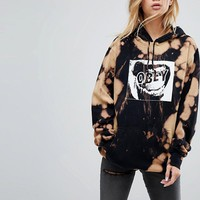 Obey Oversized Hoodie With Bleach Wash And Screamer Print at asos.com