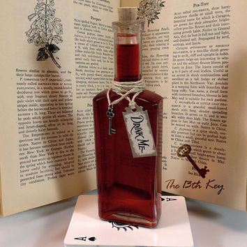 Alice in Wonderland Drink Me Bottle with Tag, Key, and Red Liquid