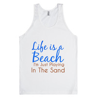 life is a beach i'm just playing in the sand