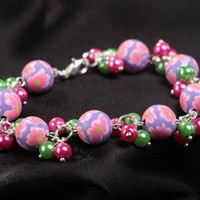 Handmade children's wrist bracelet with polymer clay beads and ceramic pearls
