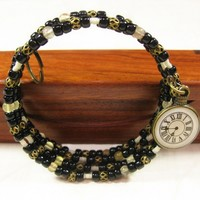 Vintage Look Beaded Wristlet, Black and Brass Tone Cutout Beads, Watch Charm