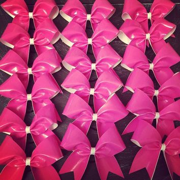 "Neon pink autograph bows approximately 6"" by6"""