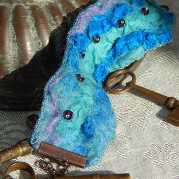 Bracelet: blue and aqua nuno felted silk and merino beaded cuff wrist warmer with adjustable copper clasp.  Boho style, casual wearable art