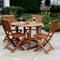 The Trestle Patio Table and Stow Away Chairs - Hammacher Schlemmer