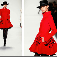 Irina Shabayeva laser cut swing coat. Worn on Kelly Clackson's Christmas album cover. Comes in red, gray and black