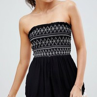 River Island Shirred Bandeau Pom Pom Beach Playsuit at asos.com