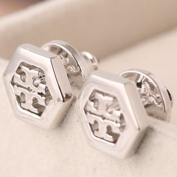Tory Burch hollow letter logo hexagon geometric stud earrings silver