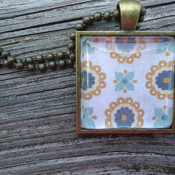 Little Blue Flowers: A pendant charm necklace made from a glass tile and a square pendant tray
