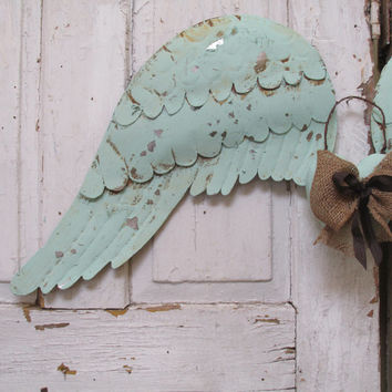 Metal angel wings wall decor distressed sea glass and burlap large tin wings with heart embellishment Anita Spero Design