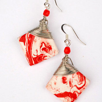 Unique handpainted white and red boho earrings. Abstract pattern pendants with wire wrapping. Hipster jewelry trend.