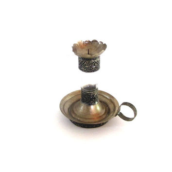 Vintage silver plated metal and glass candle holder. Shaped as an antique oil lamp. Ornate candlestick with handle.
