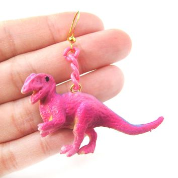 Classic Dinosaur Animal Figurine Shaped Dangle Earrings in Pink | DOTOLY