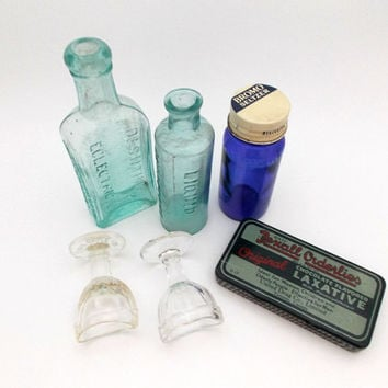 Vintage medicine bottle collection blue apothecary bottles glass, tin and glass eye wash cups drug store