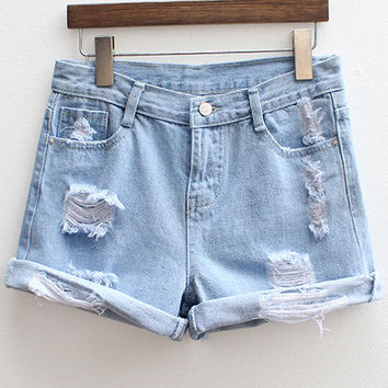 Blue Ripped Denim Shorts from Augustine's | Shorts