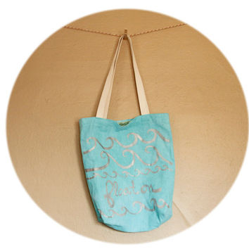 """Aqua Blue Tote Bag- cotton and linen tote with hand printed waves, """"float on,"""" in silver ink"""