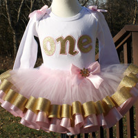 girls first birthday...ONEderland metallic gold and pink,,,pink tutu trimmed in metallic gold and pink with pink bow and gold snowflake