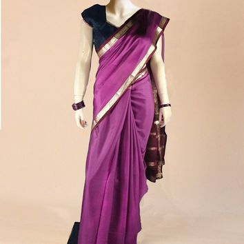 the saree in purple with subtle gold trim overlay