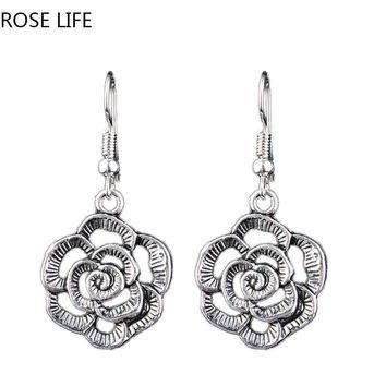 ROSE LIFE 2017 Europe And The United States Metal Hollow Carved Earrings New Fashion Flowers Lady Earrings Hot Jewelry