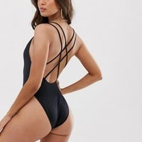 ASOS DESIGN recycled strappy back high leg swimsuit in black | ASOS