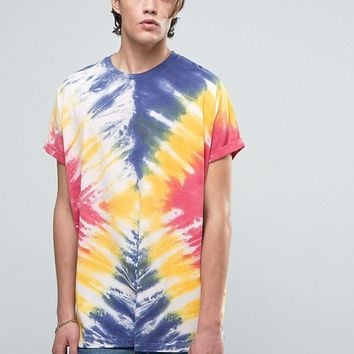 ASOS Super Oversized T-Shirt With Roll Sleeve And Bright Tie Dye Wash at asos.com