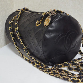Vintage CHANEL black color lambskin long chain shoulder bag in drum shape with CC motif. Most popular bag along with 2.55 classic purse.