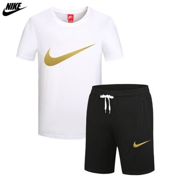 NIKE trend men's thin section sports breathable casual short-sleeved shorts running two-piece White