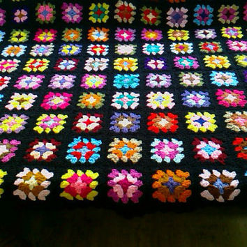 Handmade chunky crochet blanket -  Made in tradition granny type multi colour style with black border   784