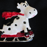 Danecraft Cow riding a sled brooch pin
