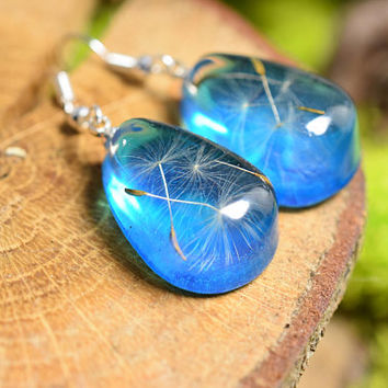 Blue resin earrings with dandelion seeds